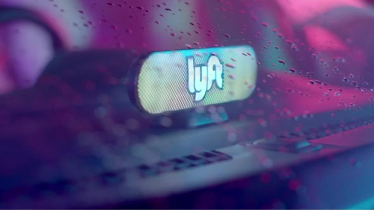 This is an undated image of a Lyft sign in a vehicle.