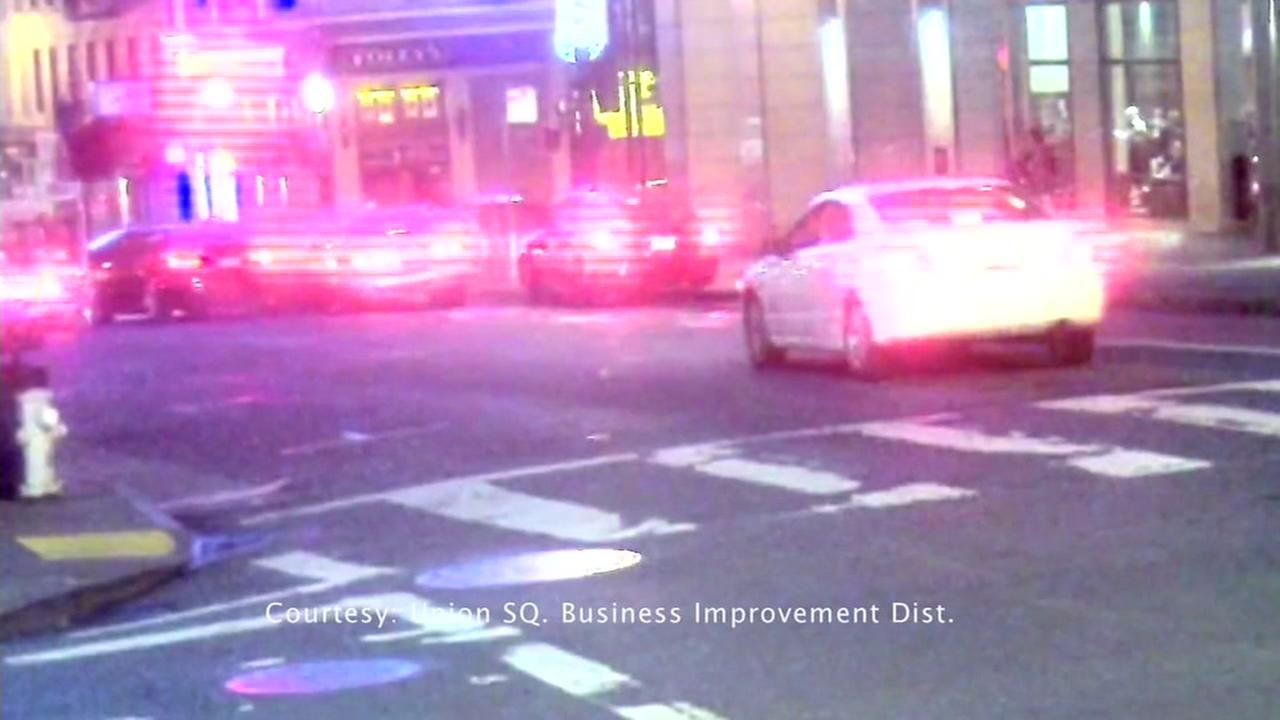 Surveillance footage shows a car crashing in the Tenderloin after a man was shot in the early hours of Tuesday, Sept. 12, 2017.