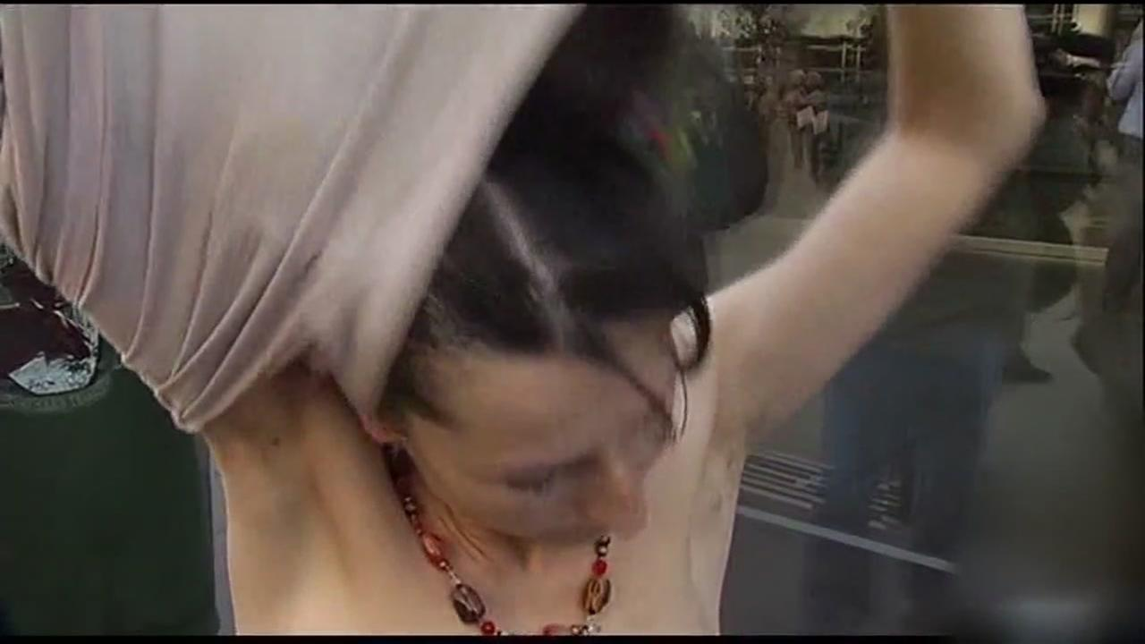 This is an undated image of a woman removing her shirt in Berkeley, Calif.