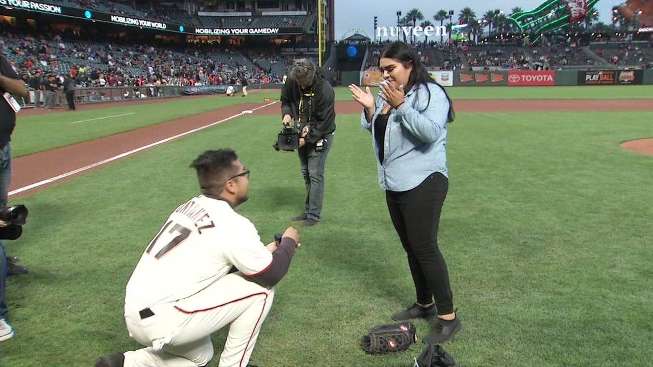 Fredi Montanez proposes to his fiance Bianca Vasquez at a San Francisco Giants game on Monday, Sept. 12, 2017.