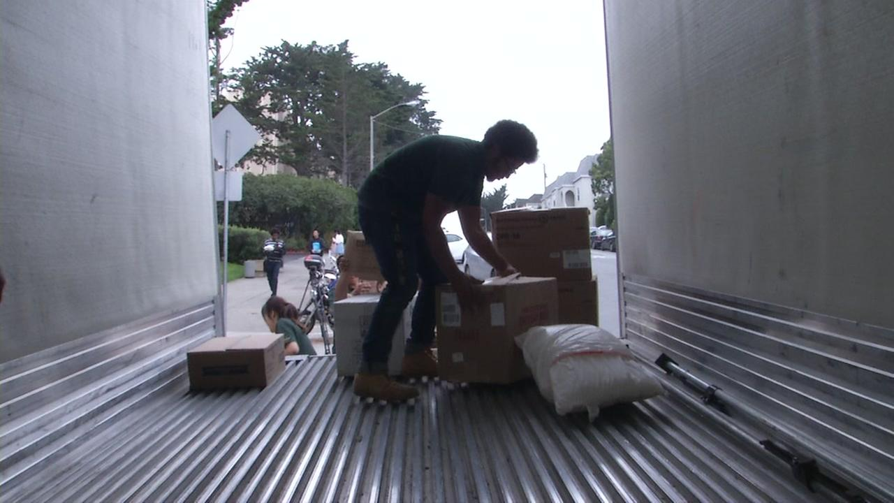 Volunteers fill a truck with supplies for Hurricane Harvey victims in San Francisco on Tuesday, Sept. 12, 2017.