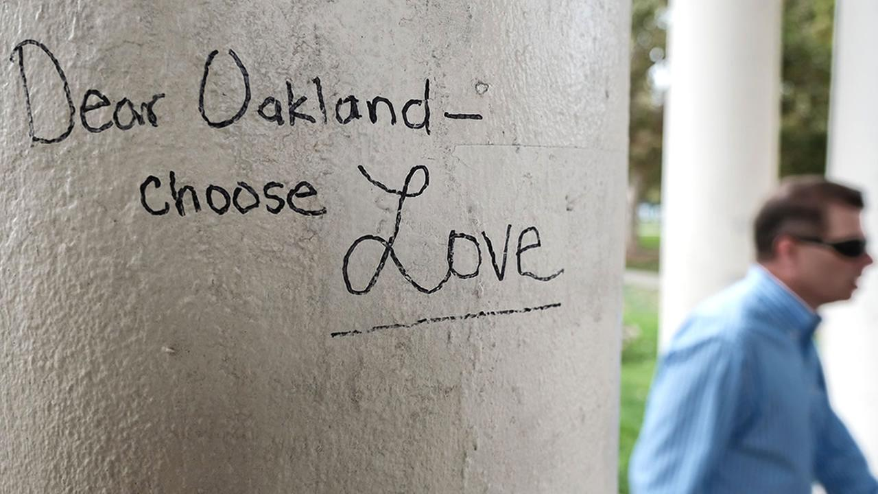 A poem appeared in place of a memorial for the victims of the Ghost Ship Fire in Oakland, Calif. City worker painted over it, calling it graffiti, on Wednesday, Sept. 13, 2017.