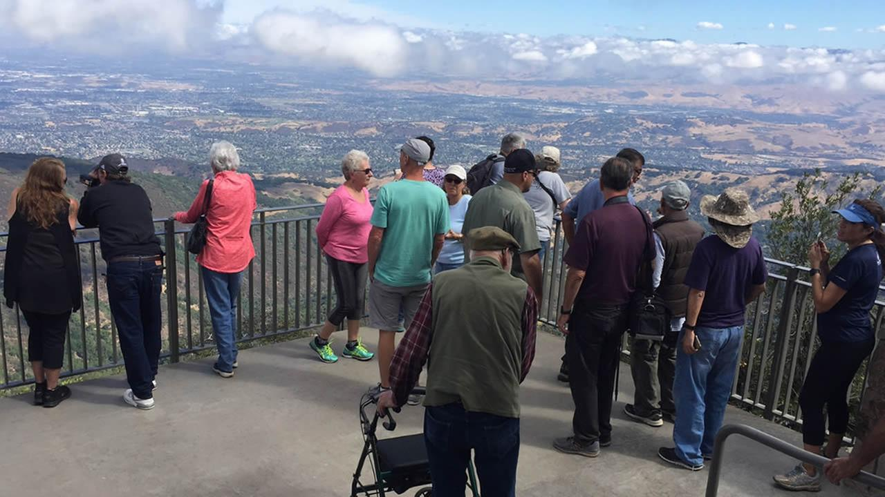 A crowd enjoys the view from Mount Umunhum on Monday, September 18, 2017.