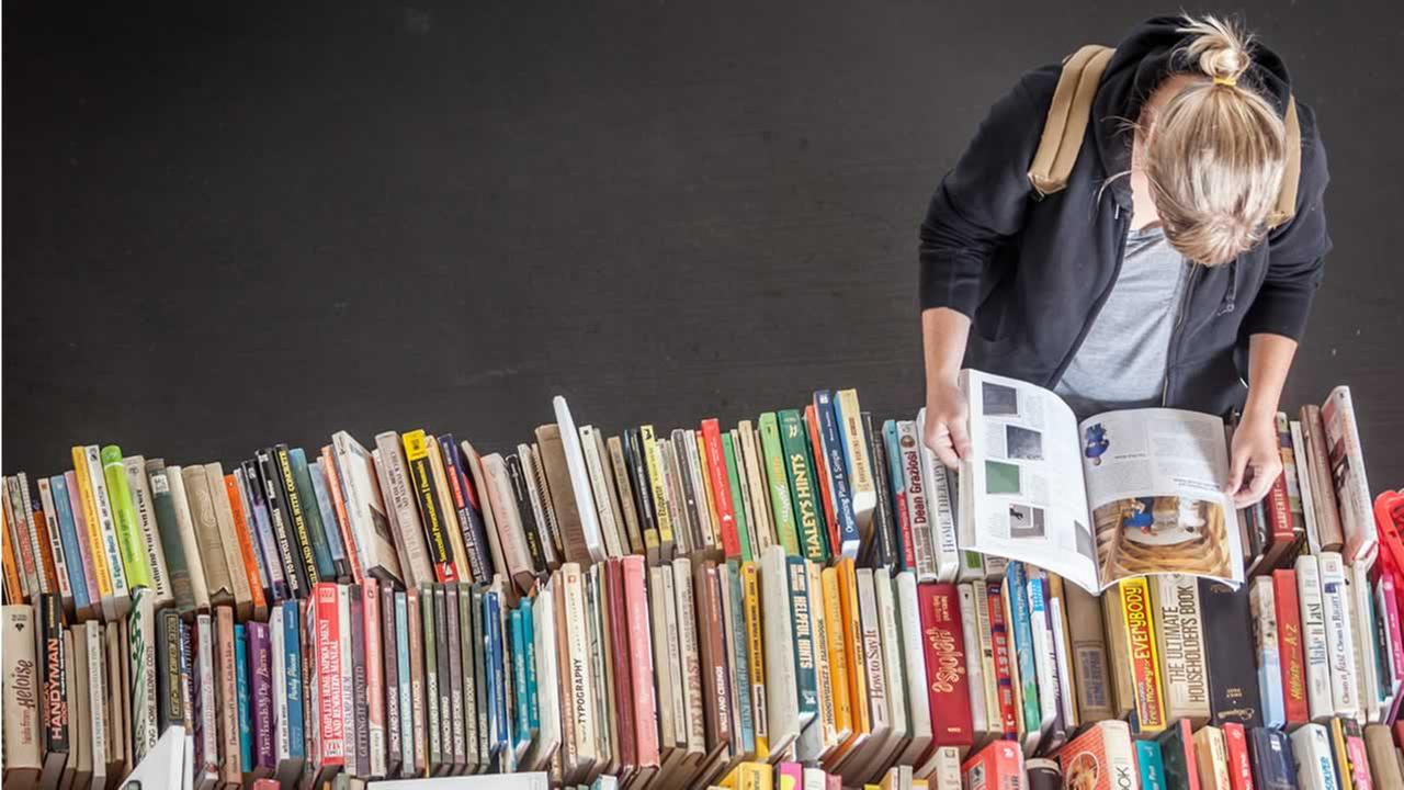A customer looks through a table full of books on Sept. 24, 2013 at Fort Mason Festival Pavilion in San Francisco.