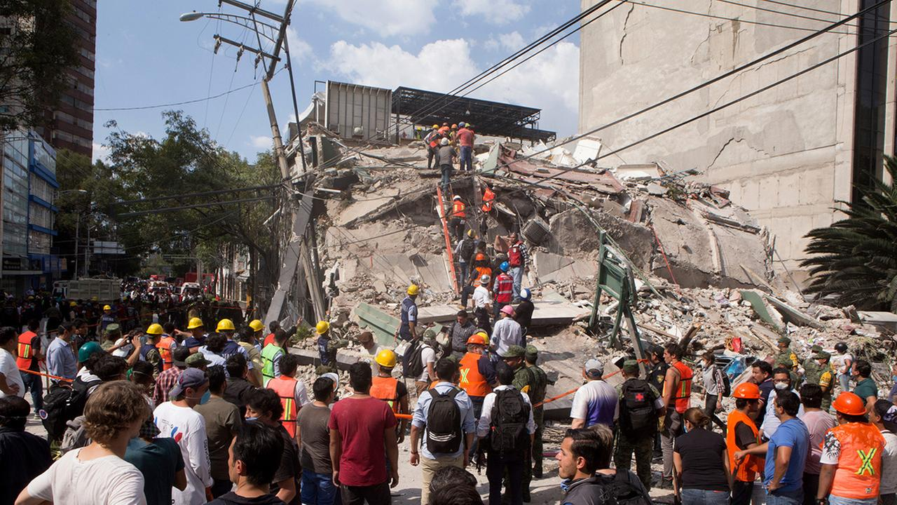 Volunteers and first responders look for survivors in a collapsed building after an earthquake struck Mexico City, Tuesday, Sept. 19, 2017.