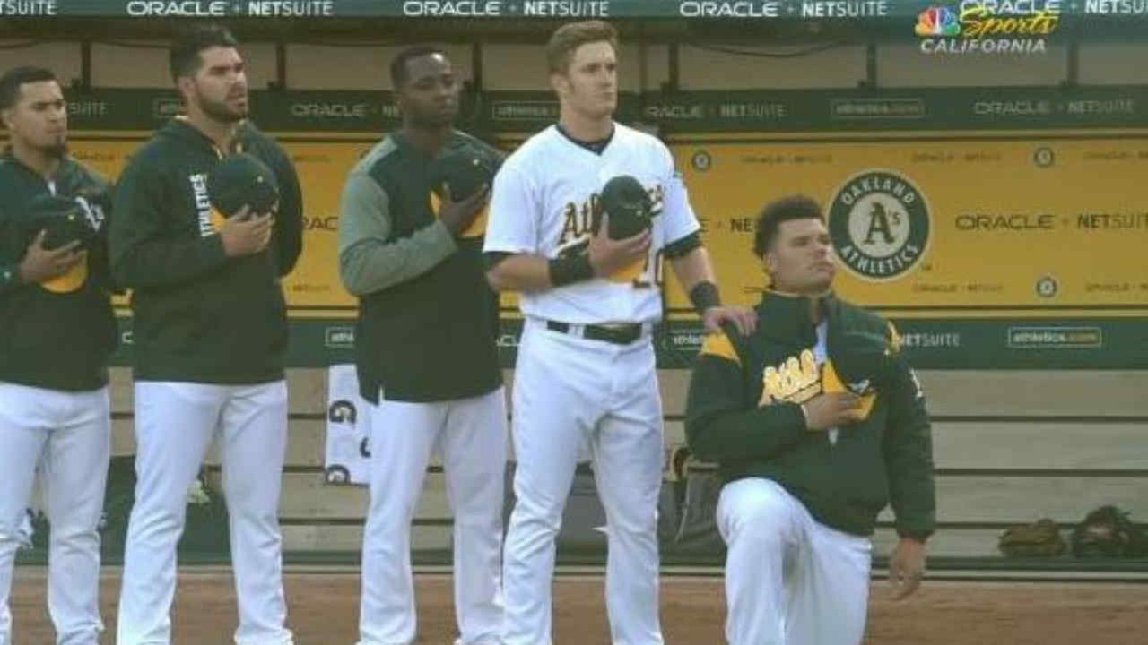 Oakland Athletics catcher Bruce Maxwell is seen kneeling during the national anthem before a game against the Texas Rangers in Oakland, Calif. on Saturday, September 23, 2017.