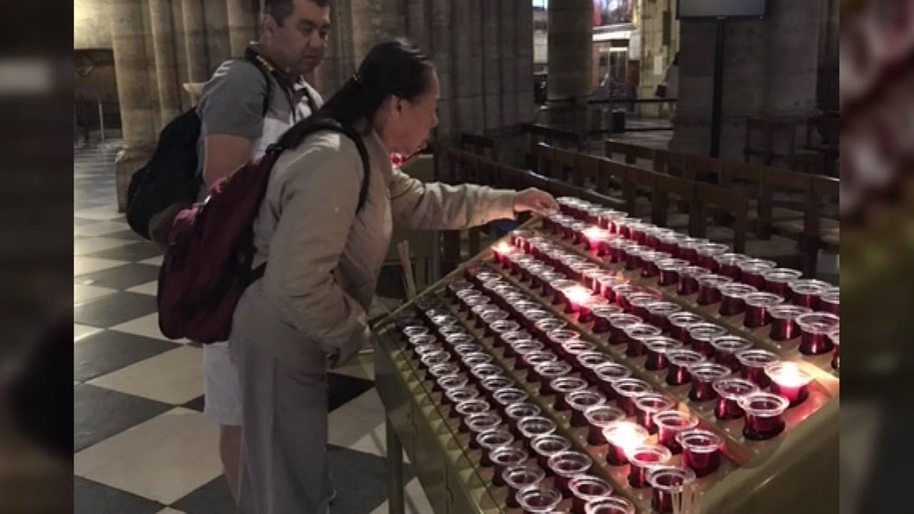 A Bay Area couple lights candles in London, England in this undated image.