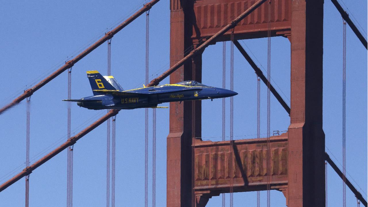 Lt. Tyler Davies, U. S. Navy Blue Angel flys near the south tower of the Golden Gate Bridge during practice Thursday, Oct. 5, 2017, in San Francisco. (AP Photo/Ben Margot)