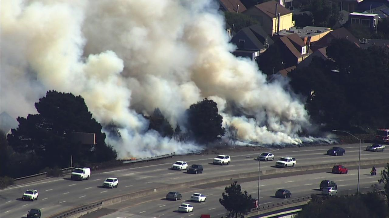 Crews battled a fire along I-280 in San Francisco on Friday, Oct. 6, 2017.