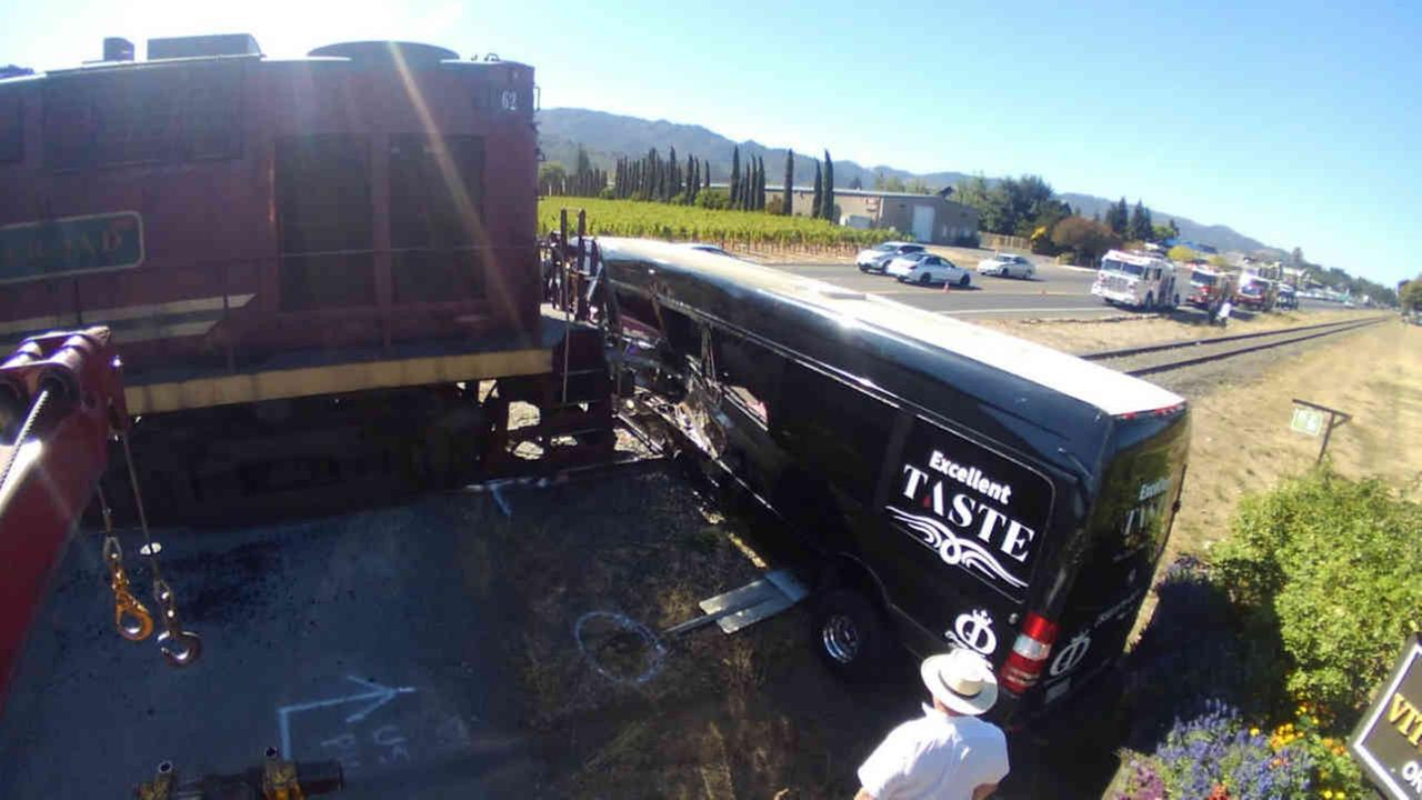 A wine train is seen crashed into a limo bus in St. Helena on Sunday, October 8, 2017.