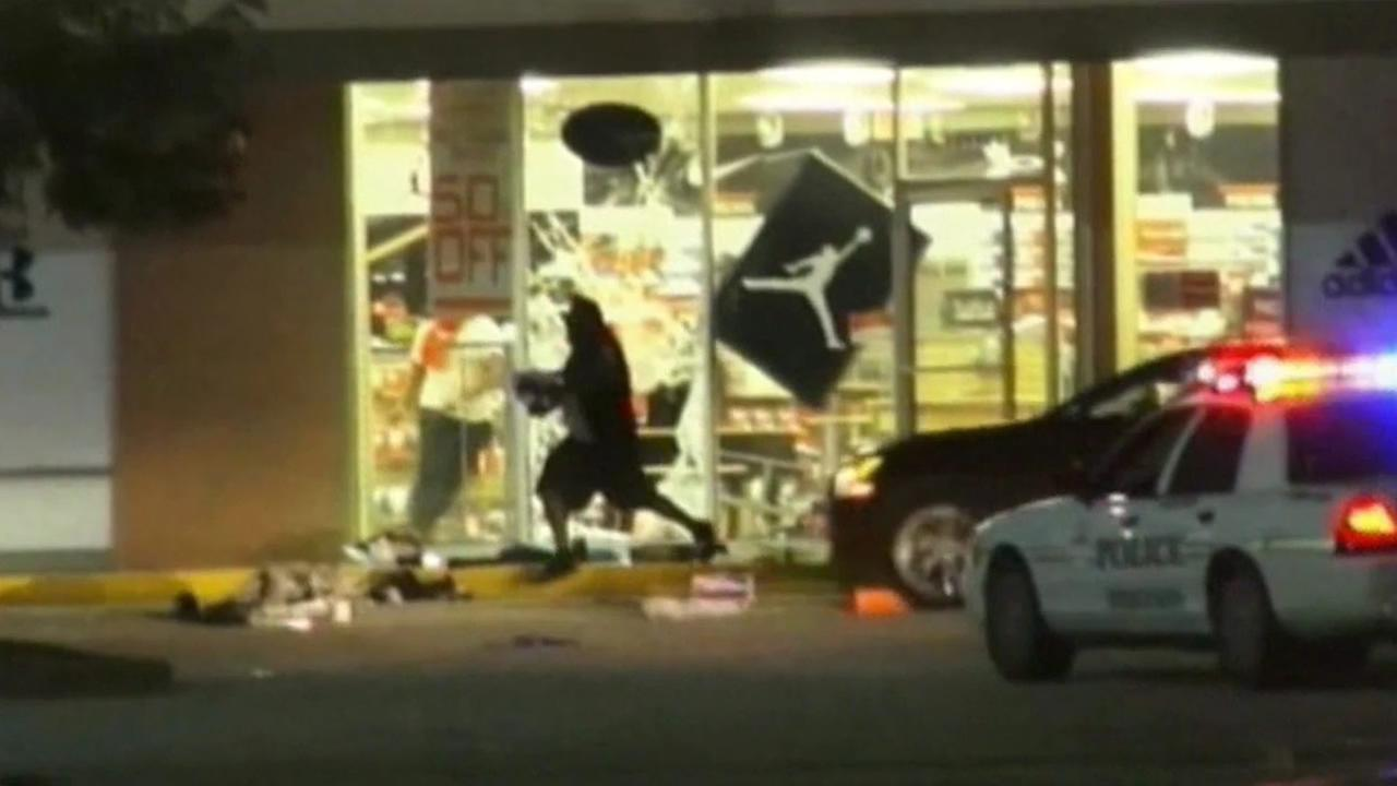 Looting reported after vigil for Missouri man shot and killed by police.