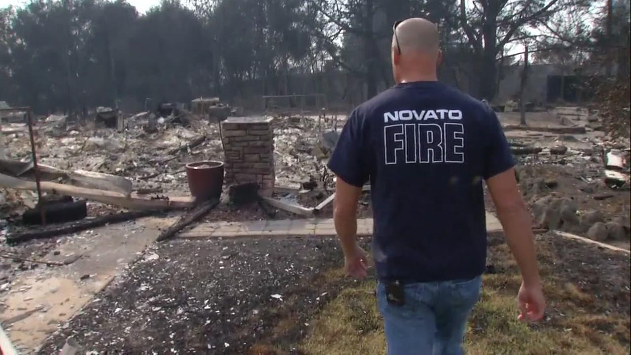 Battalion Chief Dimitri Menzel looks over the remains of his home following a wildfire in Santa Rosa, Calif. on Monday, Oct. 16, 2017.