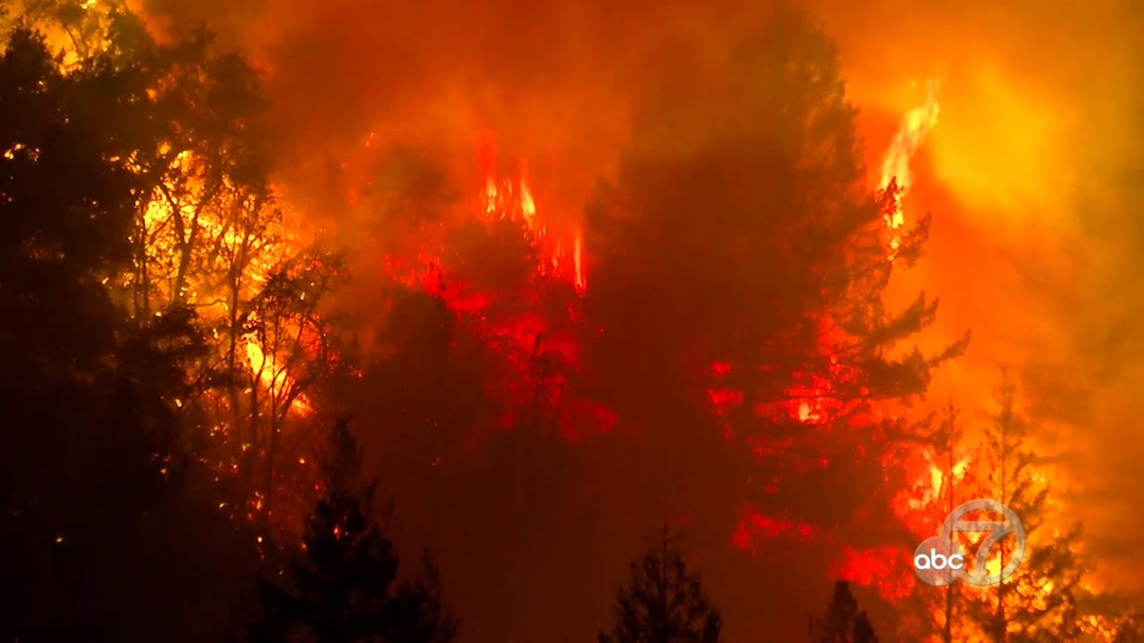 A wildfire is seen burning in Santa Cruz Mountains on Tuesday, October 17, 2017.