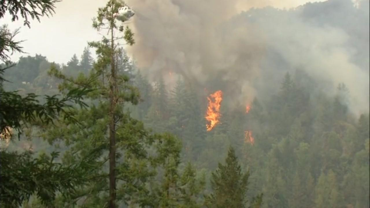 This image shows flames from the Bear Fire burning near Boulder Creek, Calif. on Tuesday, Oct. 17, 2017.