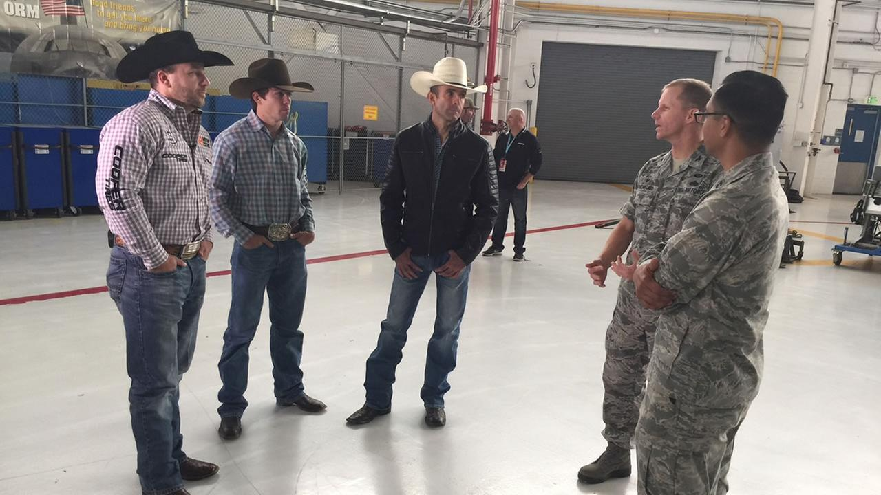 Professional bull riders stop by 129th Rescue Wing at Moffett Air National Guard Base in San Francisco on Friday, Oct. 20, 2017.
