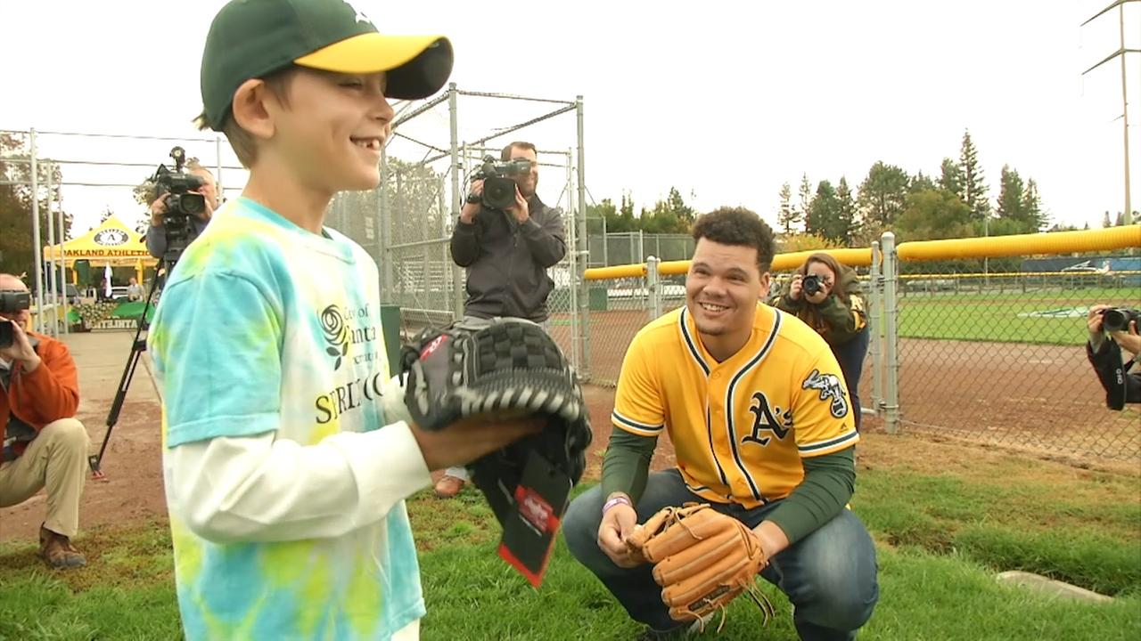 9-year-old As fan Loren Jade Smith talks to catcher Bruce Maxwell on Friday, Oct. 20, 2017 in Santa Rosa, Calif.