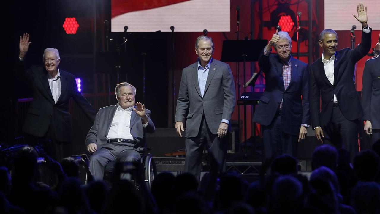 Former Presidents from right, Barack Obama, Bill Clinton, George W. Bush, George H.W. Bush and Jimmy Carter gather on stage at the opening of a hurricanes relief concert in College Station, Texas, Saturday, Oct. 21, 2017.