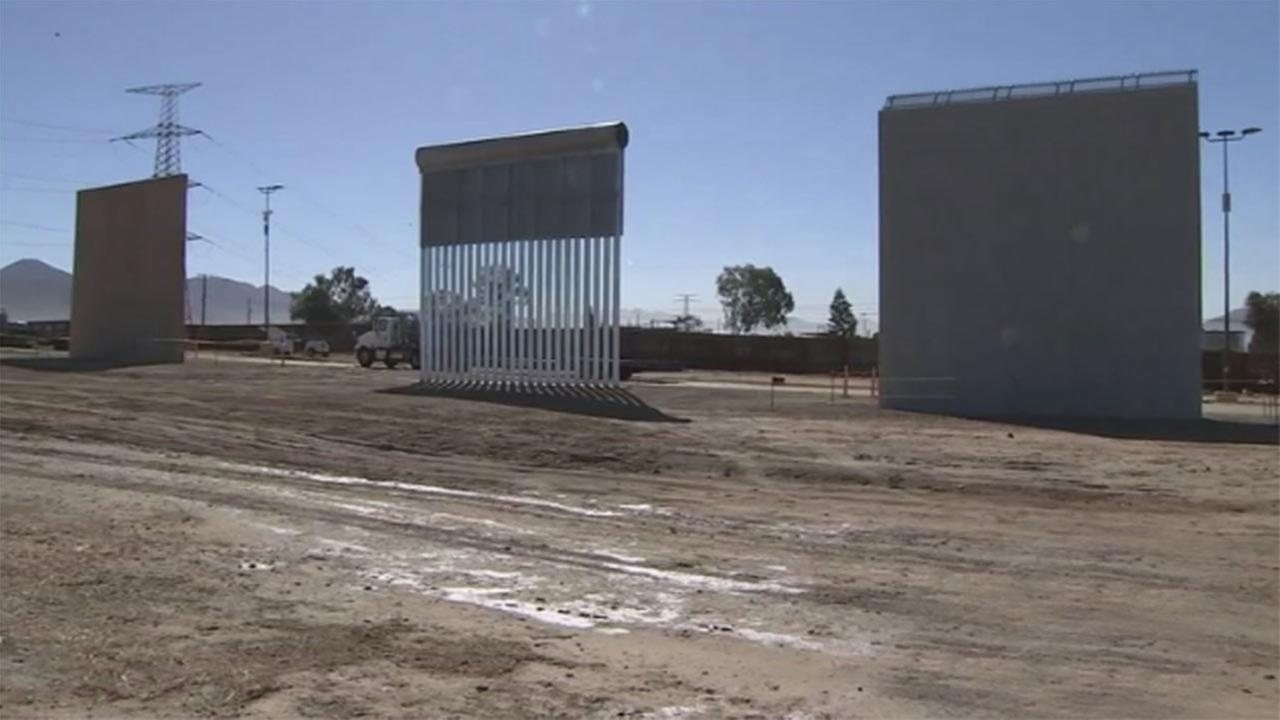 Prototypes of President Donald Trumps proposed border wall are going up near San Diego.