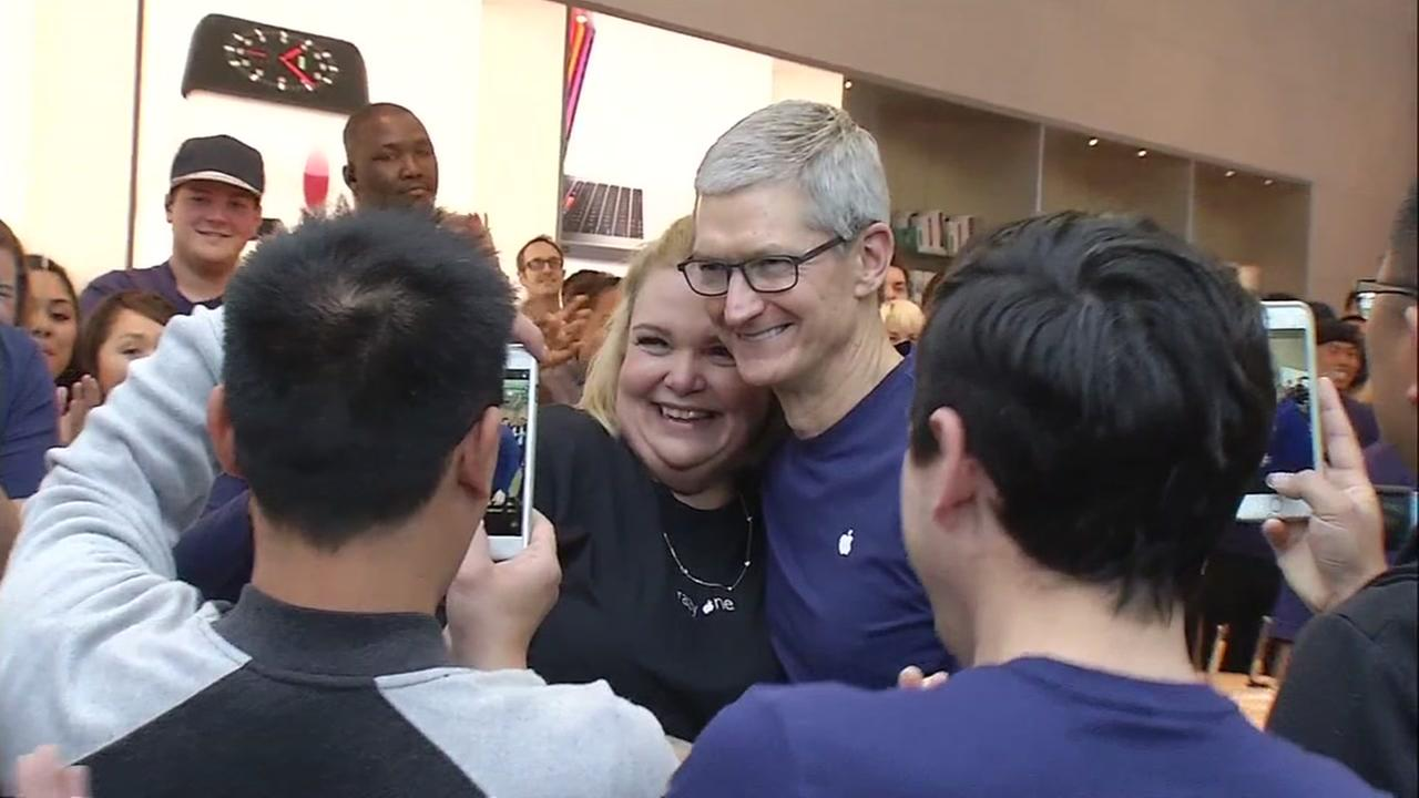 Apple CEO Tim Cook welcomes customer at Apple store in Palo Alto, California, Friday, November 3, 2017.