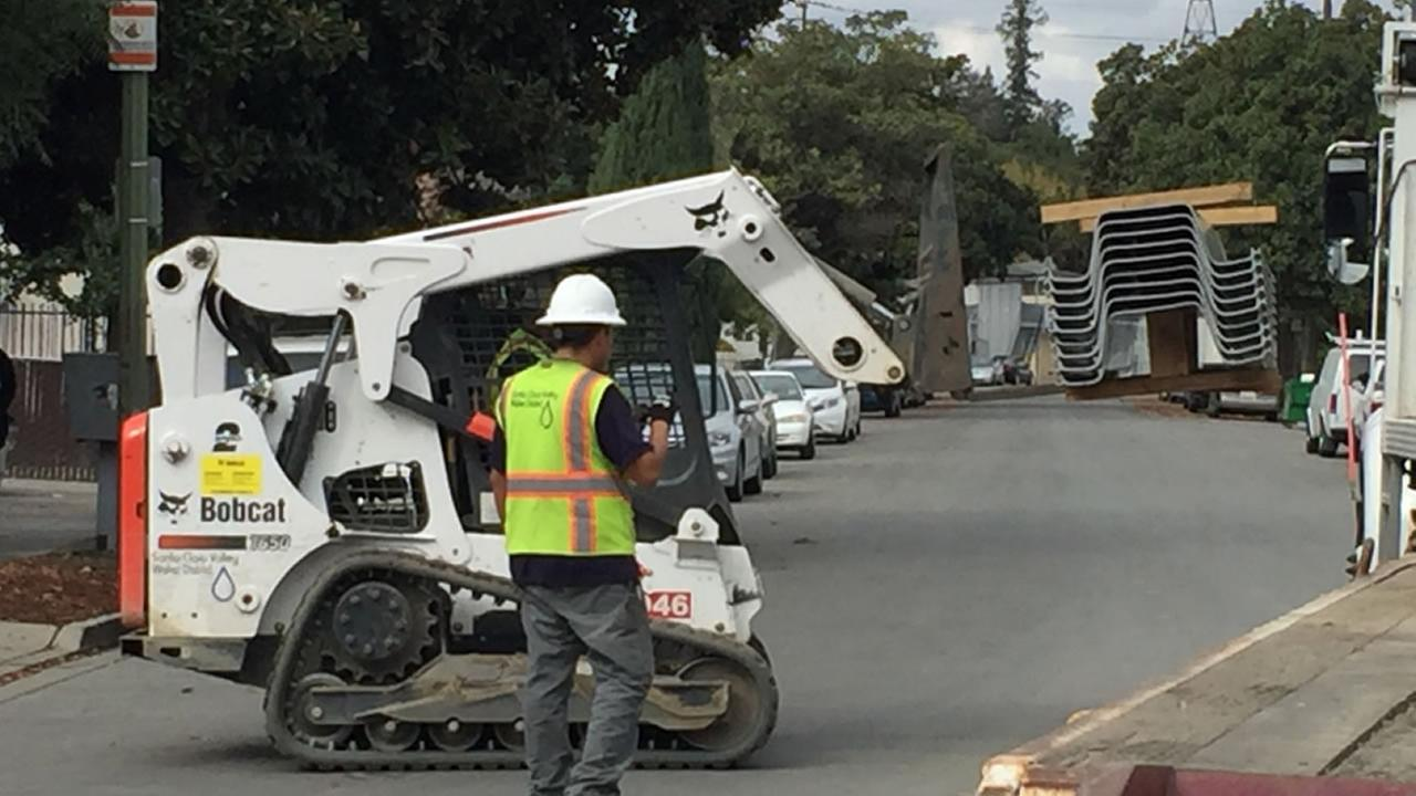 This is an image of crews working near Coyote Creek in San Jose, Calif. ahead of the rainy season, on Friday, Nov. 3, 2017.