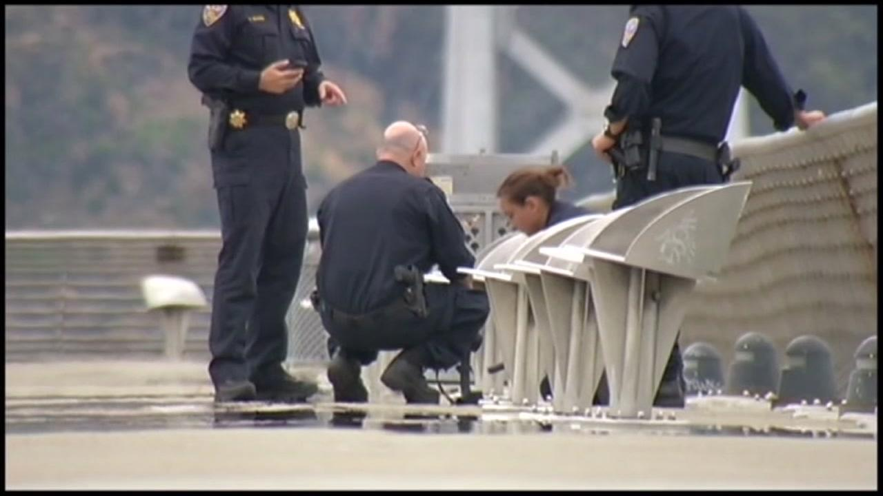 Officials examine the Kate Steinle murder scene in San Francisco in this file image.