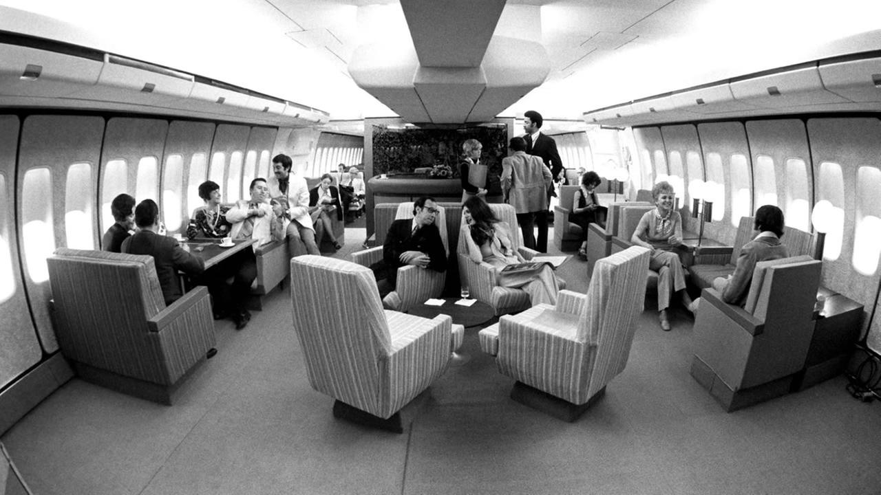 United Airlines passengers lounge in luxury in this image from the 70s.