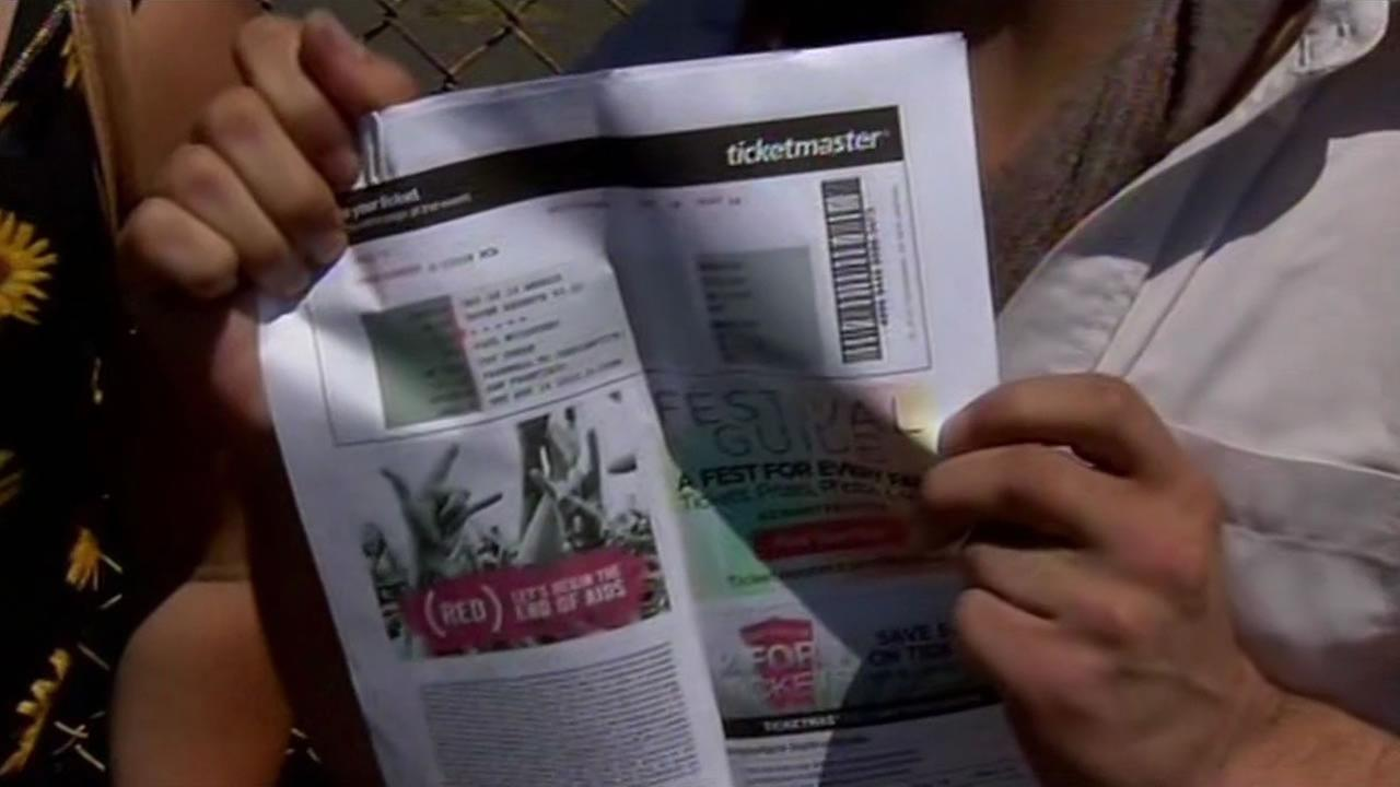 Concertgoer shows off Paul McCartney ticket.