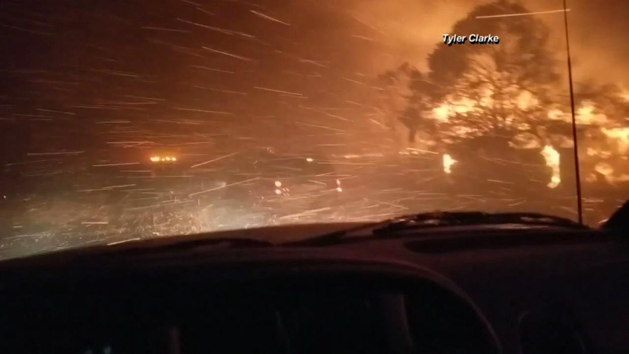Tyler Clarke shared this video on social media of him driving through the flames in the North Bay.