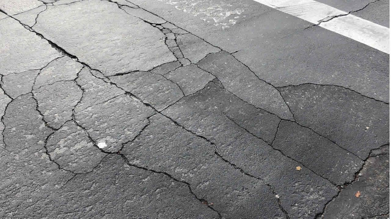 A street with cracks in the concrete is seen on Thursday, November 9, 2017.