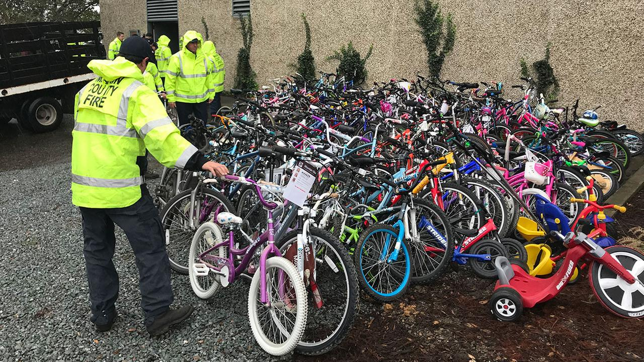 Firefighters help donate bikes in Mill Valley, California, Friday, November 10, 2017.