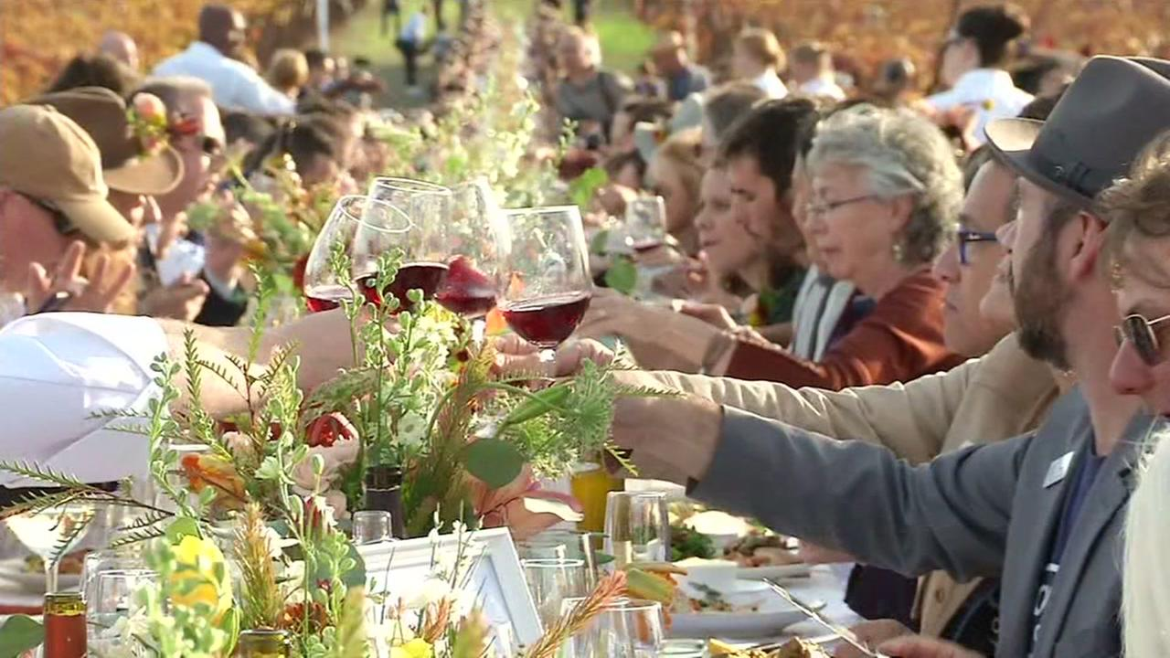 Diners raise a glass to first responders at a Thanksgiving in Sonoma, Calif. on Tuesday, Nov. 21, 2017.
