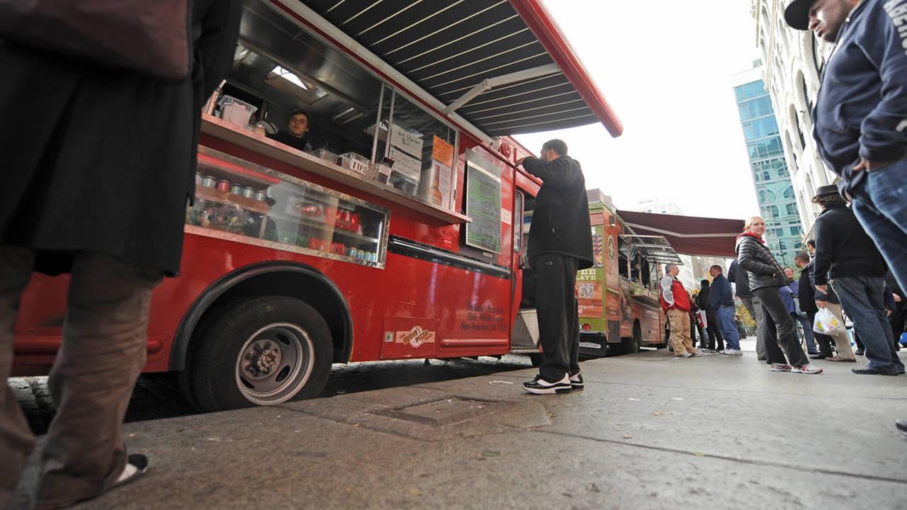 Food trucks service the still powerless Union Square section of Manhattan,Thursday, Nov. 1, 2012, in New York (AP Photo/ Louis Lanzano)