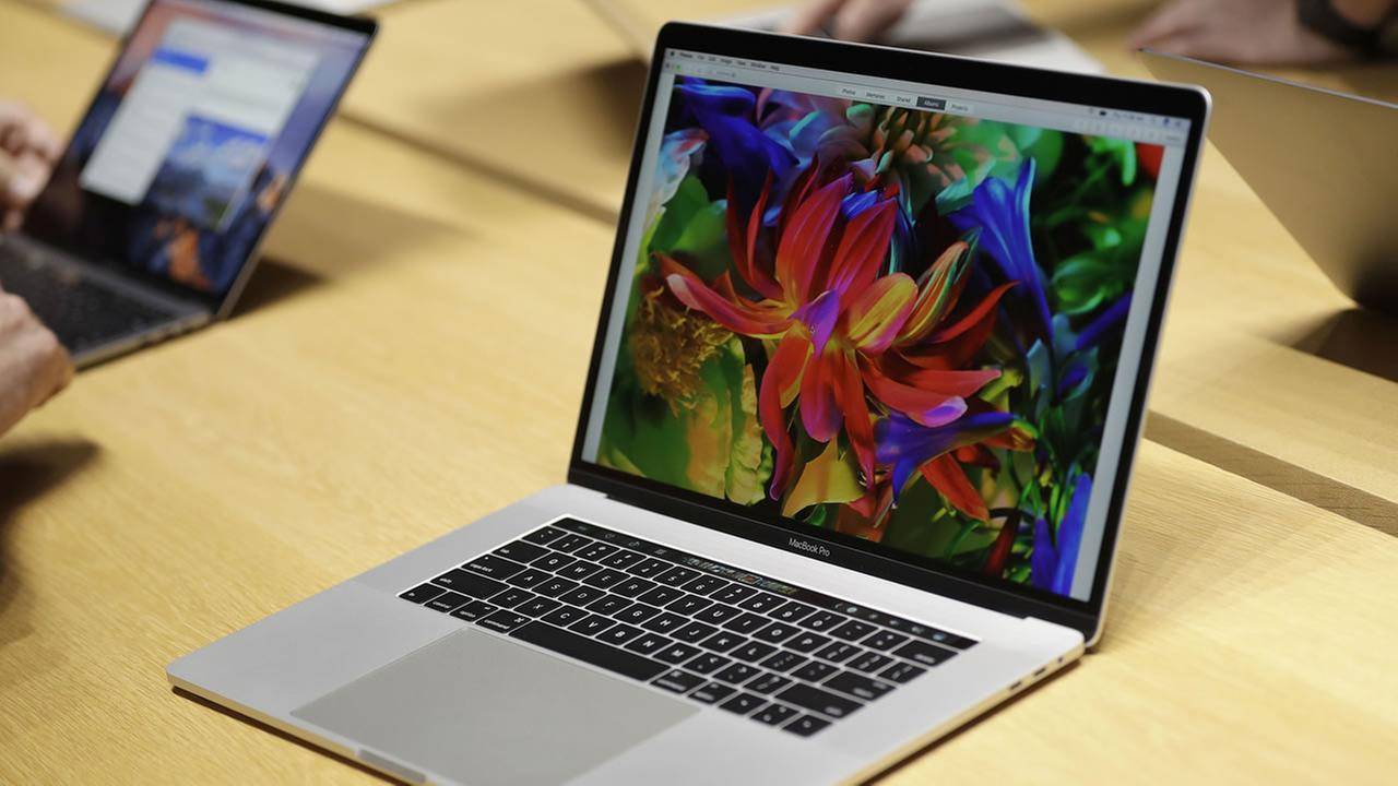 This Thursday, Oct. 27, 2016, file photo, shows MacBook computers in a demo room following the announcement of new products at Apple headquarters, in Cupertino, Calif.
