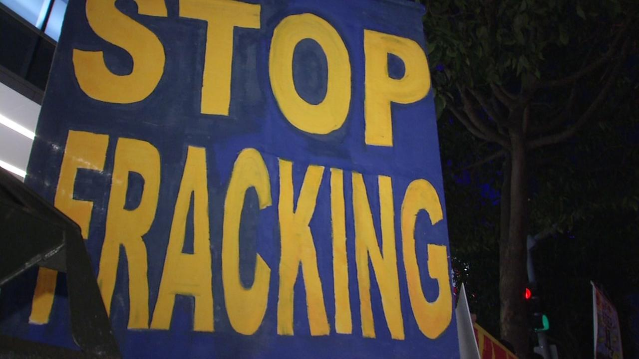 A stop fracking protest sign appears at the New York Times Climate Tech Summit in San Francisco on Wednesday, Nov. 29, 2017.