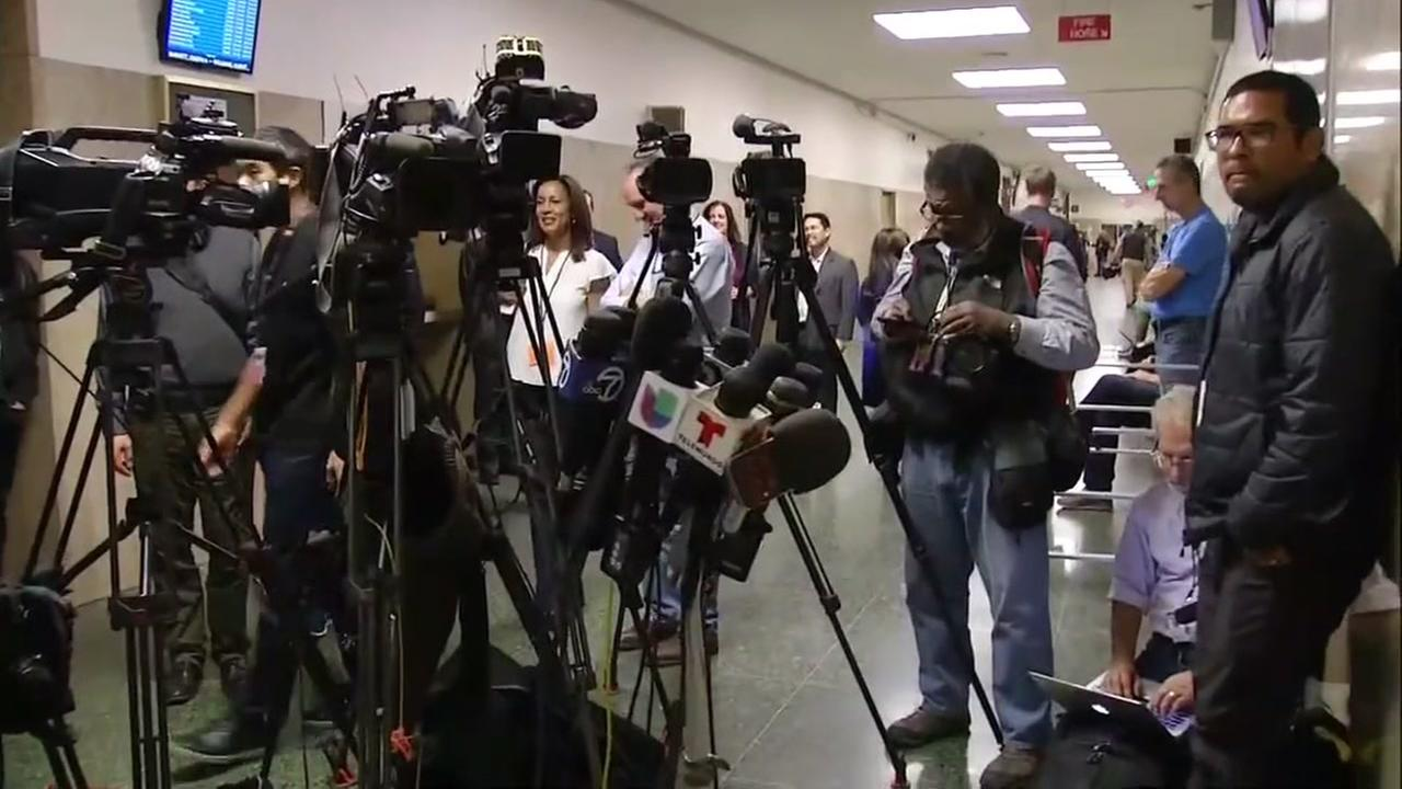 Microphones and cameras are set up outside the San Francisco courtroom after the jury in the Kate Steinle murder trial announced they reached a verdict on Thursday, Nov. 30, 2017.