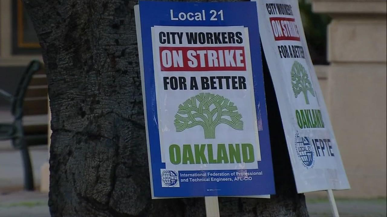 A picket sign leans up against a tree in Oakland, Calif. on Wednesday, Dec. 6, 2017.
