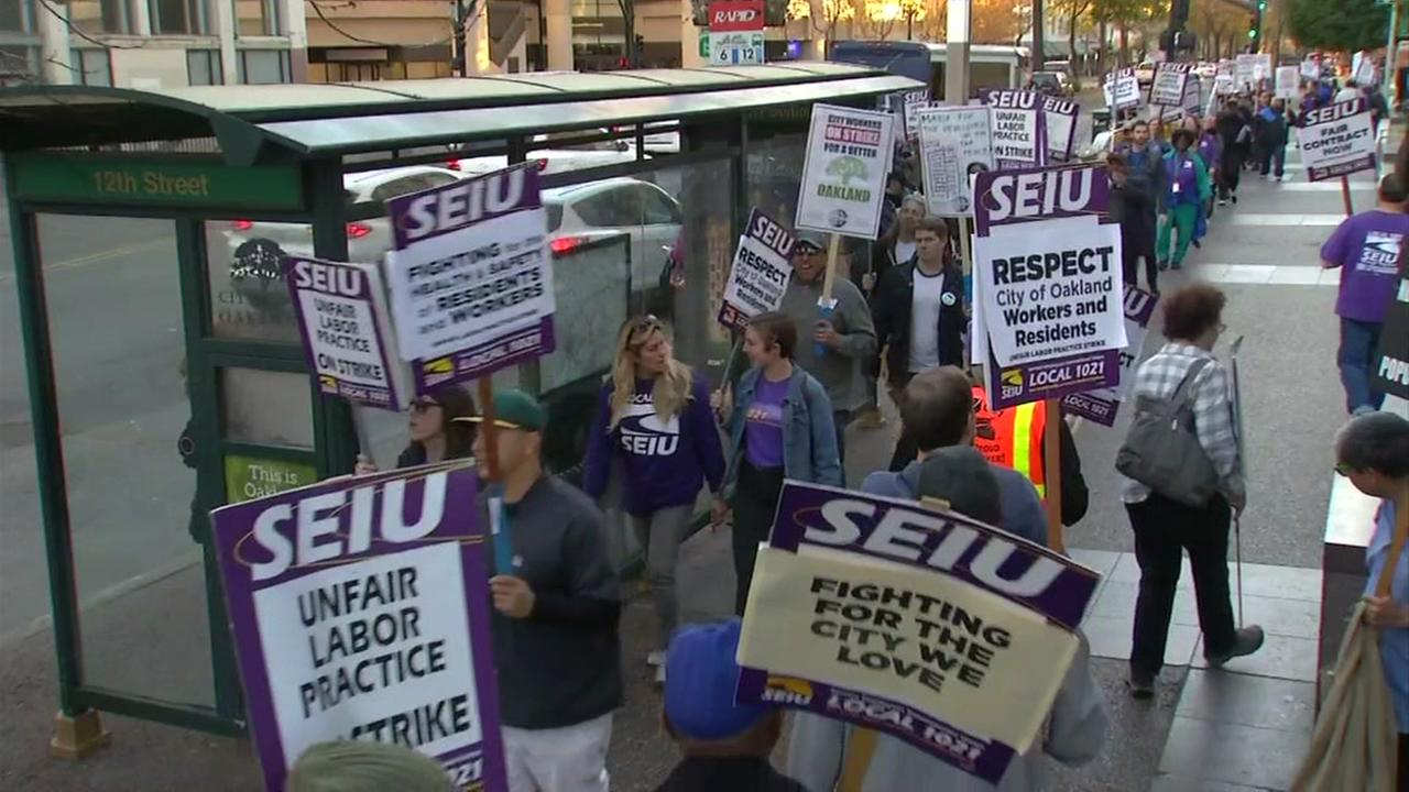 City workers picket in Oakland, Calif. on Wednesday, Dec. 6, 2017.