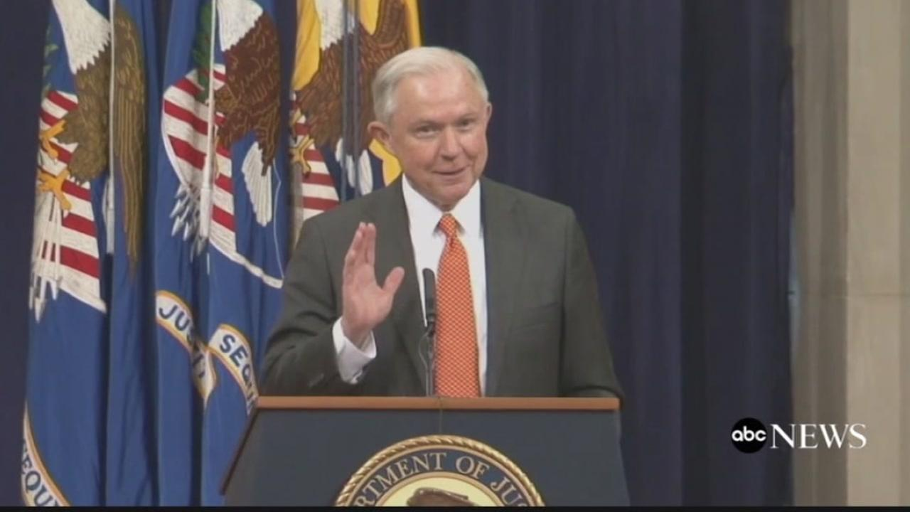 Attorney General Jeff Sessions holds his hand up during an exchange with a UC Berkeley student on Thursday, Dec. 7, 2017.