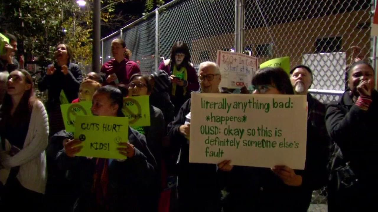 Parents protest outside an Oakland School Board meeting in Oakland, Calif. on Friday, Dec. 7, 2017.