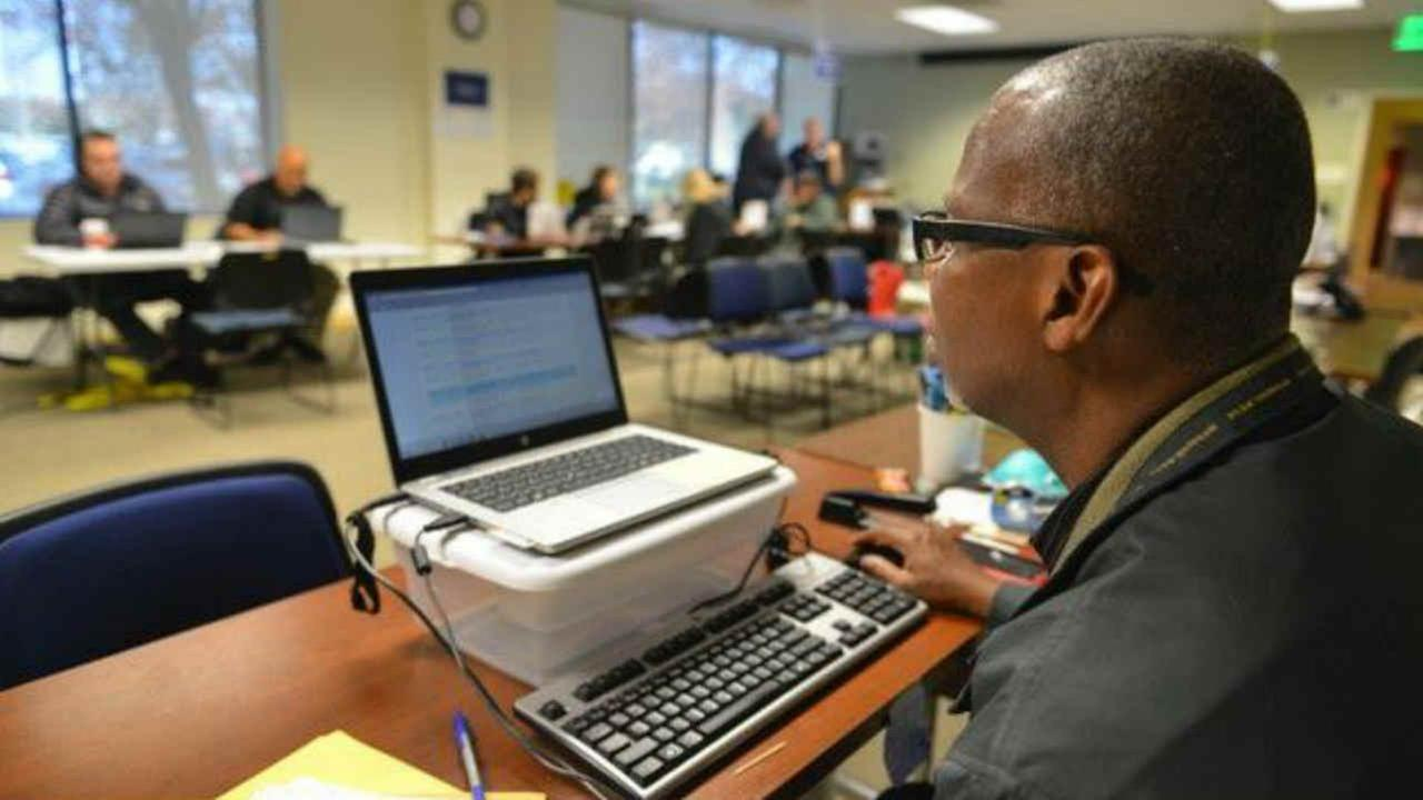 A worker is seen looking on at the Napa County Local Assistance Center in Napa, Calif. on Monday, December 11, 2017.