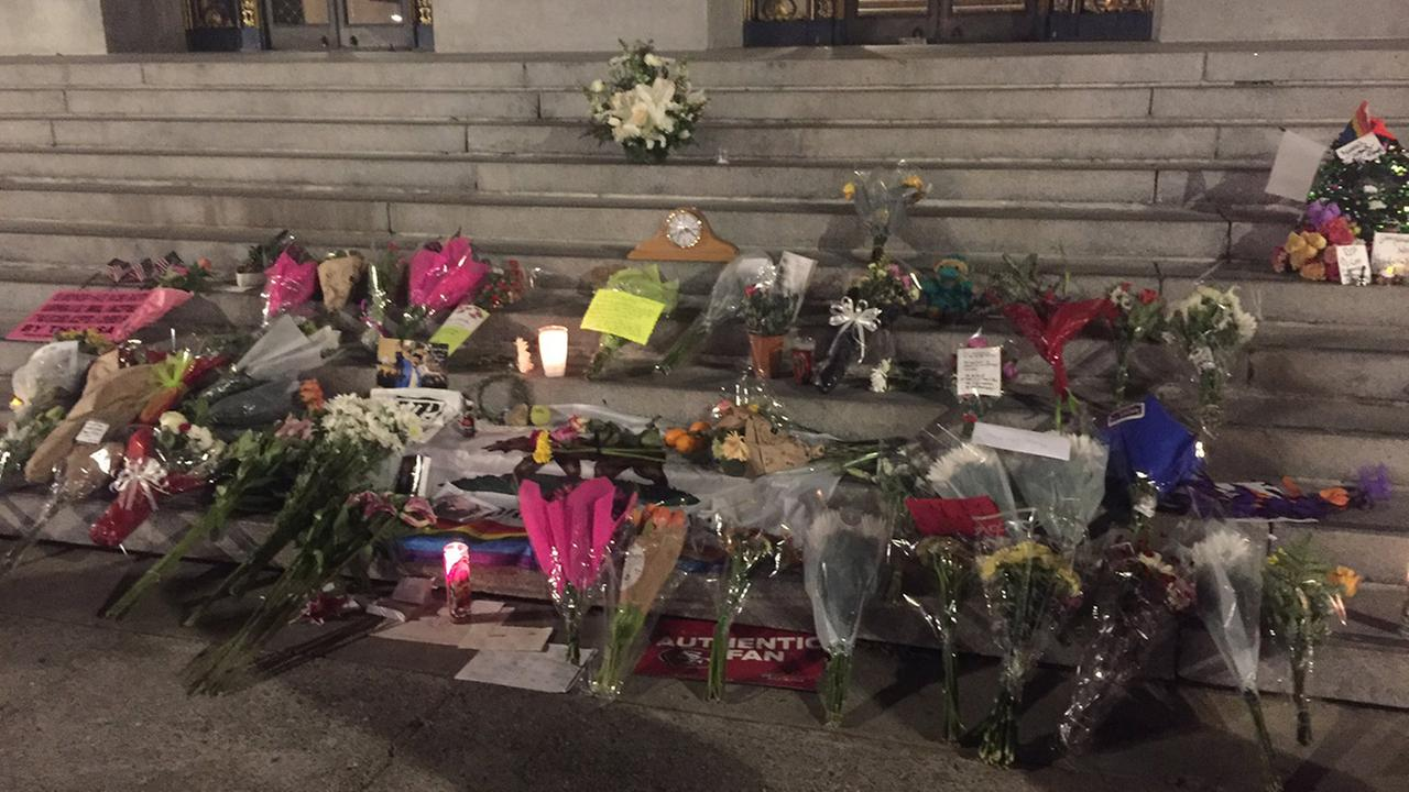 Flowers left for Mayor Ed Lee on steps of San Francisco City Hall, Wednesday, December 13, 2017.