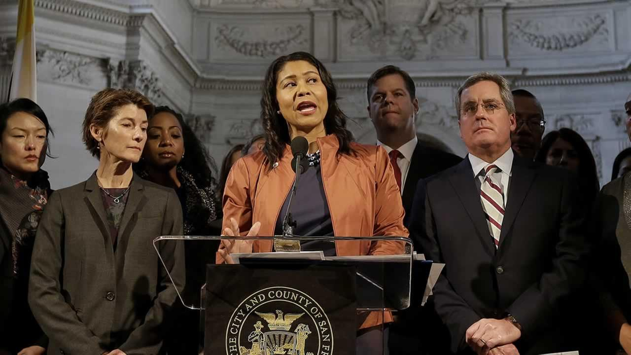 San Francisco Board of Supervisors President and acting mayor London Breed, center, speaks at a news conference at City Hall in San Francisco, Tuesday, Dec. 12, 2017.