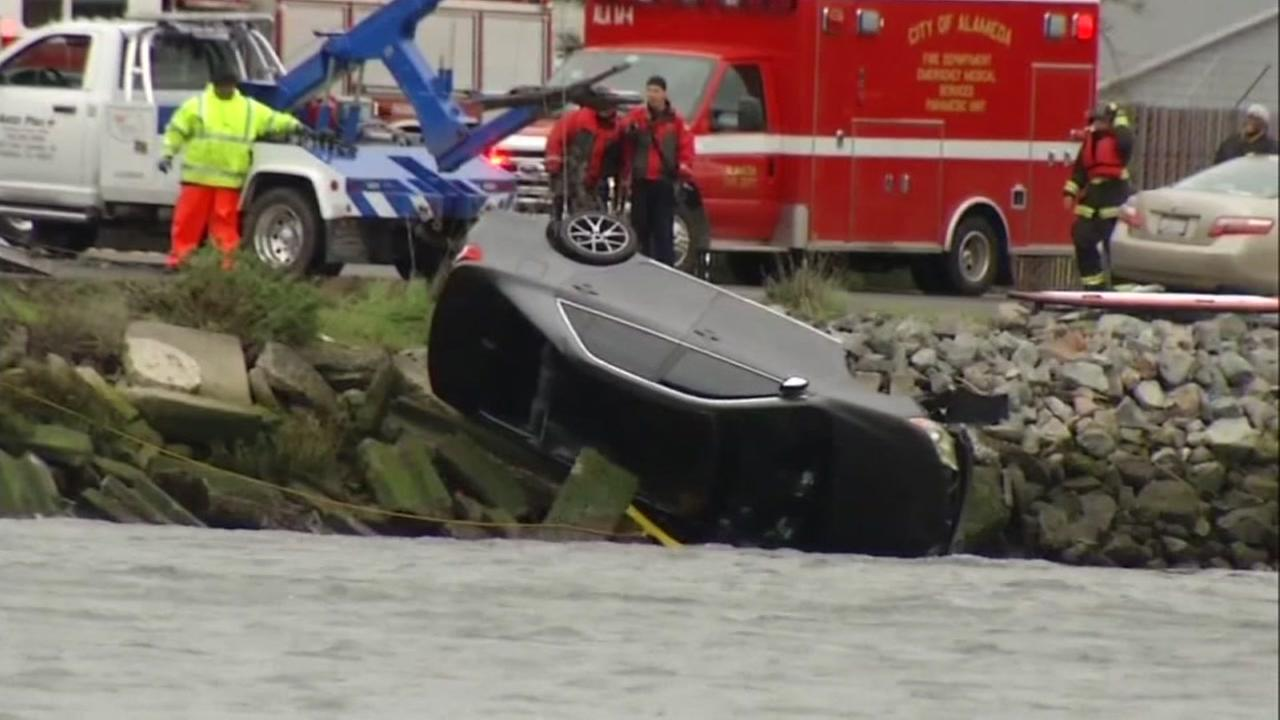 A car is seen being pulled out of the water of the Oakland Estuary in this undated image.