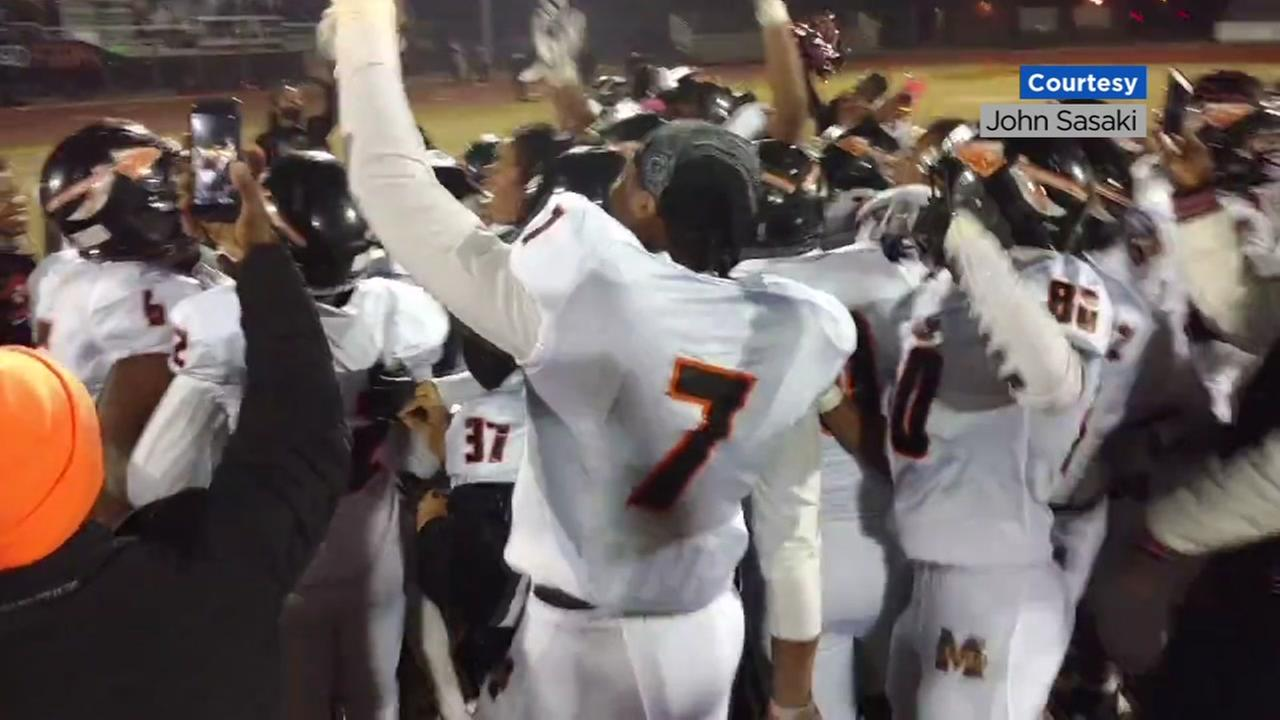 The McClymonds Warriors high school football team celebrates their second state championship title in Oakland, Calif. in 2017.