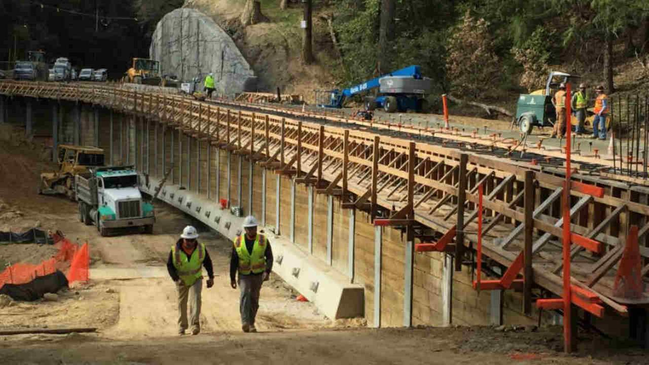 Construction crews are seen on a stretch of Highway 35 near Los Gatos on Tuesday, Dec. 19, 2017.