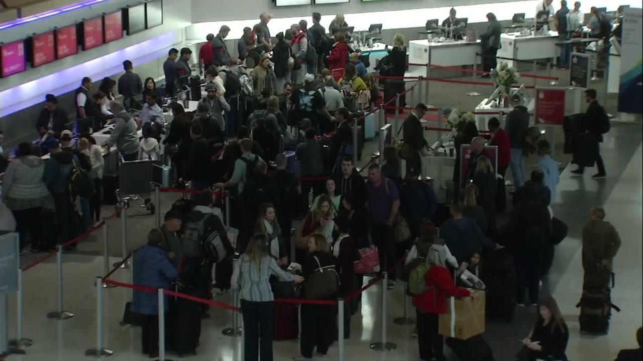 Holiday travelers are seen lining up to check in, in this undated image.