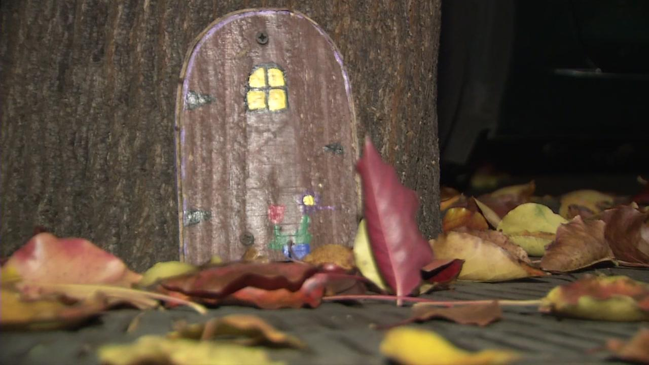 A tiny, whimsical fairy door appears in Alameda, Calif. on Tuesday, Dec. 19, 2017.
