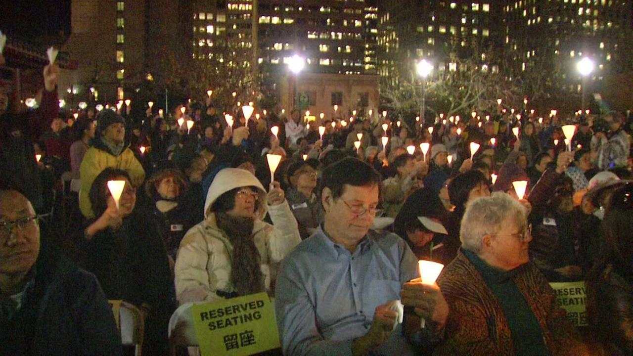Mourners gather to honor former San Francisco Mayor Ed Lee with a vigil in Chinatown on Thursday, Dec. 21, 2017.