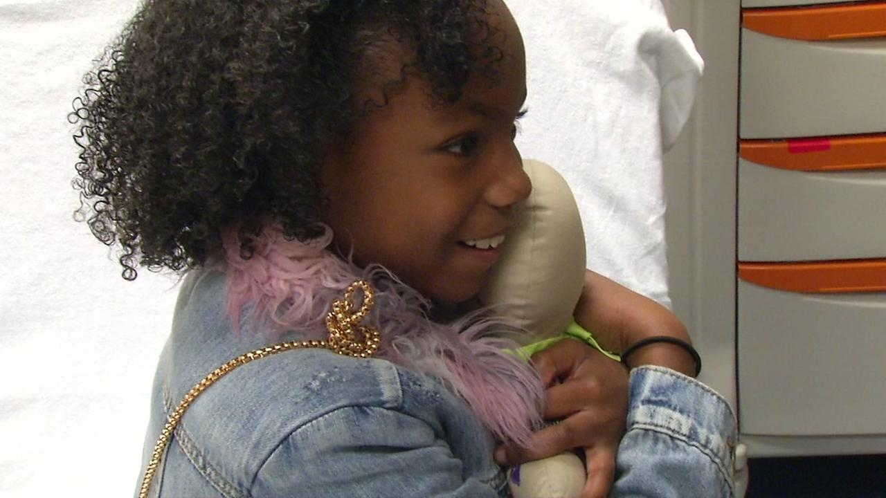 Kennedi, 9, holds her stuffed doll at UC Benioff Childrens Hospital in San Francisco in this undated image.