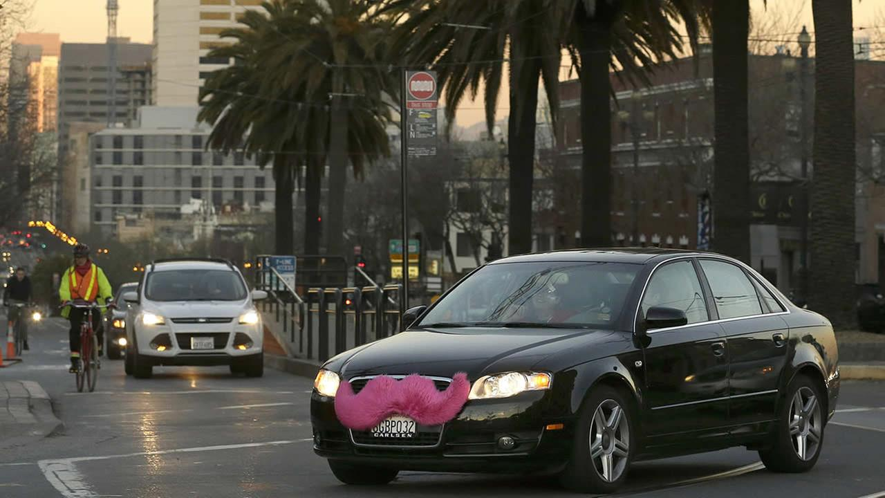 In this Jan. 17, 2013, file photo, a Lyft car crosses Market Street in San Francisco. (AP Photo/Jeff Chiu, File)